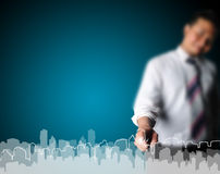 Business man drawing city. With blue background Stock Photo