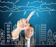 Business man drawing city life with hard rain Stock Image