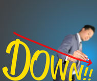 Business man drawing curve of down Stock Photography