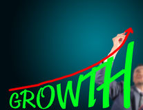 Business man drawing curve of growth Royalty Free Stock Photos