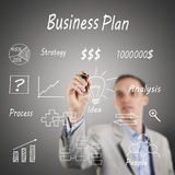 Business man drawing a diagram on a glass wall royalty free stock photo
