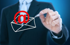 Business man drawing electronic mail icon Royalty Free Stock Images