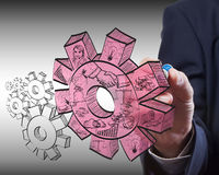Business man drawing gears to success Royalty Free Stock Photos