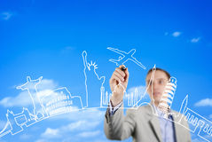 Business man drawing on a glass wall royalty free stock photos
