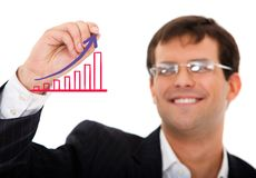 Business man drawing a graph Royalty Free Stock Photos