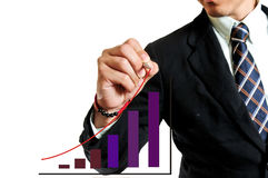 Business man drawing graph Royalty Free Stock Image