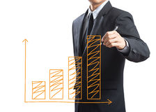 Business man drawing a growing graph. Business man drawing growing graph on screen Stock Photo