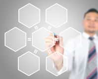 Business man drawing hexagonal. Touch screens button for business strategy Stock Image