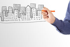 Business man drawing house of property Royalty Free Stock Photos