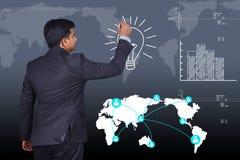 Business man drawing the light bulb Stock Photos