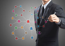 Business man drawing social network structure Royalty Free Stock Photography