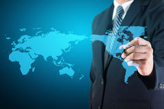 Business man drawing with world map Royalty Free Stock Photos