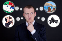 Business man dreaming about vacation over dark background Stock Images