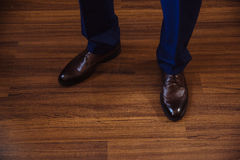 Business man dressing up with classic, elegant shoes. Groom wearing on wedding day, tying the laces and preparing. Royalty Free Stock Photography