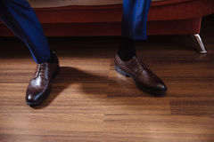 Business man dressing up with classic, elegant shoes. Groom wearing on wedding day, tying the laces and preparing. Royalty Free Stock Photos