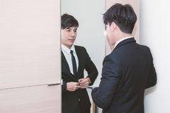 Free Business Man Dressing Up For Work In Front Of The Mirror Stock Photography - 101666702