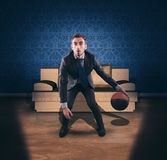 Business man dribbling in front Stock Photo