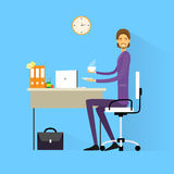 Business man drink coffee sitting at desk in Stock Photo