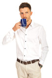 Business man drinking coffee Royalty Free Stock Images