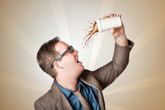 Business man drinking a quick coffee on the go Royalty Free Stock Photography