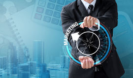 Business man drive compass for marketing direction Royalty Free Stock Image