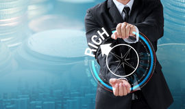 Business man drive compass to rich Stock Photo