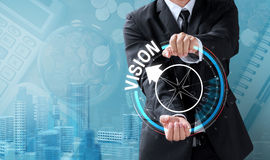 Business man drive compass for vision Stock Photo