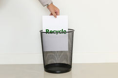 Business man drop a useless paper in to the trash. For idea and business concept stock images