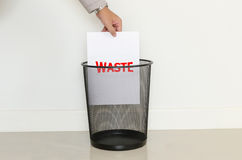 Business man drop a useless paper in to the trash Royalty Free Stock Image