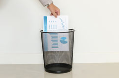 Business man drop a useless paper in to the trash Royalty Free Stock Images