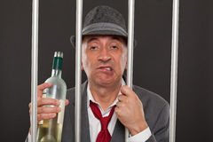 Business man drunk in jail Royalty Free Stock Photography