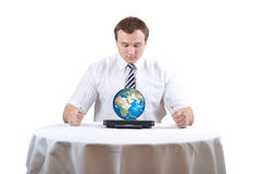 Business man and Earth Stock Photo