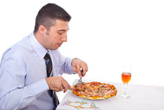 Business man eating pizza royalty free stock images