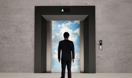 Business man and elevator open Royalty Free Stock Image
