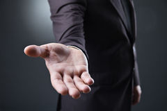 Business man with empty hand on dark background Royalty Free Stock Photo