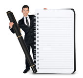 Business man with empty notepad and pen Royalty Free Stock Images