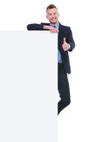 Business man with empty pannel shows ok Royalty Free Stock Photo