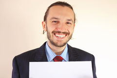 Business man with an empty white card Stock Images