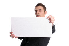 Business man with an empty white card. Isolated in white background - focus on the card stock photos