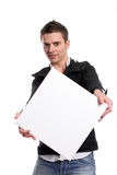 Business man with an empty white card. Isolated in white background stock photo