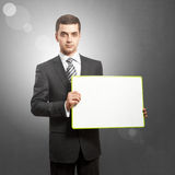 Business Man with Empty Write Board. Business man holding empty write board in his hands Royalty Free Stock Photo
