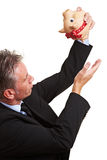 Business man emptying piggy bank Royalty Free Stock Photo