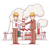 Business man and engineer shaking hands Stock Images
