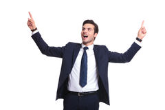 Business man enjoying his succes. Handsome business man enjoying his success, holding both hands up and screaming stock photography
