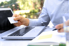Business man  entering  data of  a credit card . On-line shoppin Royalty Free Stock Image