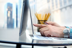 Business man entering data of a credit card . On-line shopping on the internet using a laptop.  Royalty Free Stock Images