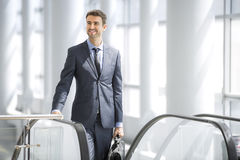 Business man on escalator Stock Photo