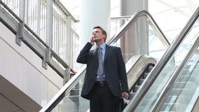 Business man on escalator Royalty Free Stock Images