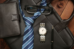 Business man essentials. Collection of style accessories. Business man essentials: leather background. Collection of style accessories Royalty Free Stock Images