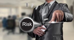 Business man examining risk Royalty Free Stock Photos